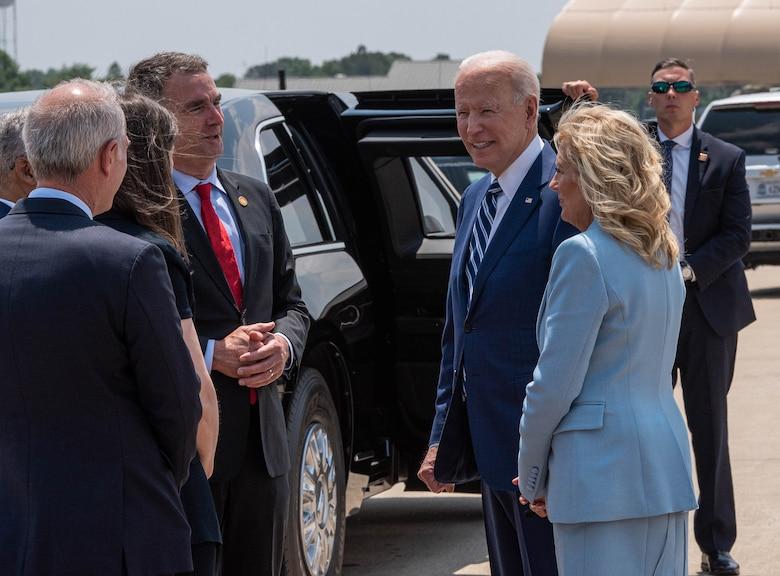 President Joe Biden and first lady Jill Biden interact with elected officials.