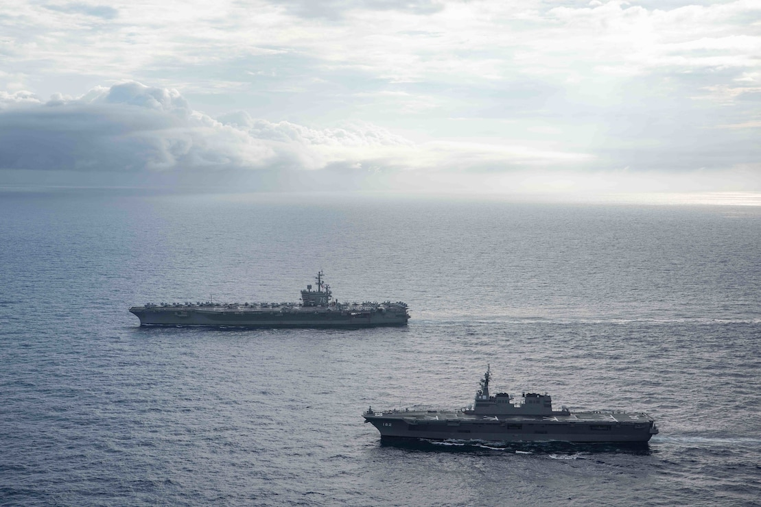 PHILIPPINE SEA (May 29, 2021) Japan Maritime Self-Defense Force Hyuga-class helicopter destroyer JS Ise (DDH 182) steams alongside the U.S. Navy's only forward-deployed aircraft carrier USS Ronald Reagan (CVN 76). Ronald Reagan, the flagship of Carrier Strike Group 5, provides a combat-ready force that protects and defends the United States, as well as the collective maritime interests of its allies and partners in the Indo-Pacific region.
