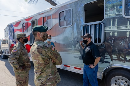 U.S. Army Sgt. 1st Class Timothy French, right, assigned to the U.S. Army North Caisson Platoon, describes the advantages of the caisson platoon's new trailer to Lt. Col. Richard Teta, center, U.S. Army North battalion commander, and Capt. William Giddens, left, Headquarters Support Company, Headquarters and Headquarters Battalion, U.S. Army North commander, on Joint Base San Antonio - Fort Sam Houston, April 8, 2021.