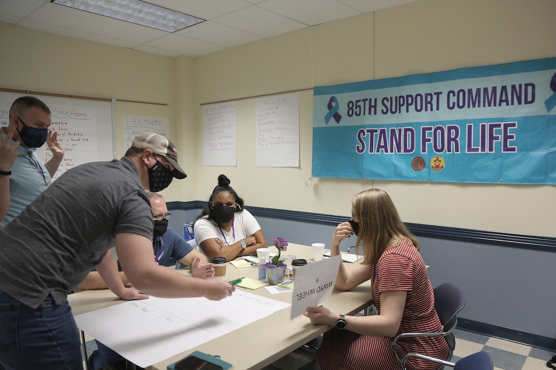 Suicide prevention liaisons participate in groups for a 'What would you do?' scenario-based exercise during a Stand for Life training event at Camp Bullis, Texas, May 11, 2021.