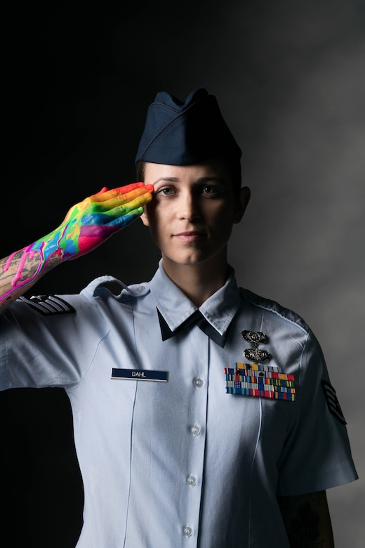 Staff Sgt. Bryanna Dahl, 436th Airlift Wing occupational safety technician, salutes with a rainbow painted on her hand at Dover Air Force Base, Delaware, May 26, 2021. The Department of Defense recognizes June as Pride Month, celebrating the history of LGBTQ service members who have bravely served and sacrificed in the U.S. military. Pride Month also upholds the DoD's commitment to diversity and inclusion in all military branches. (U.S. Air Force photo illustration by Mauricio Campino) (Multiple photographs were combined to create a final portrait)