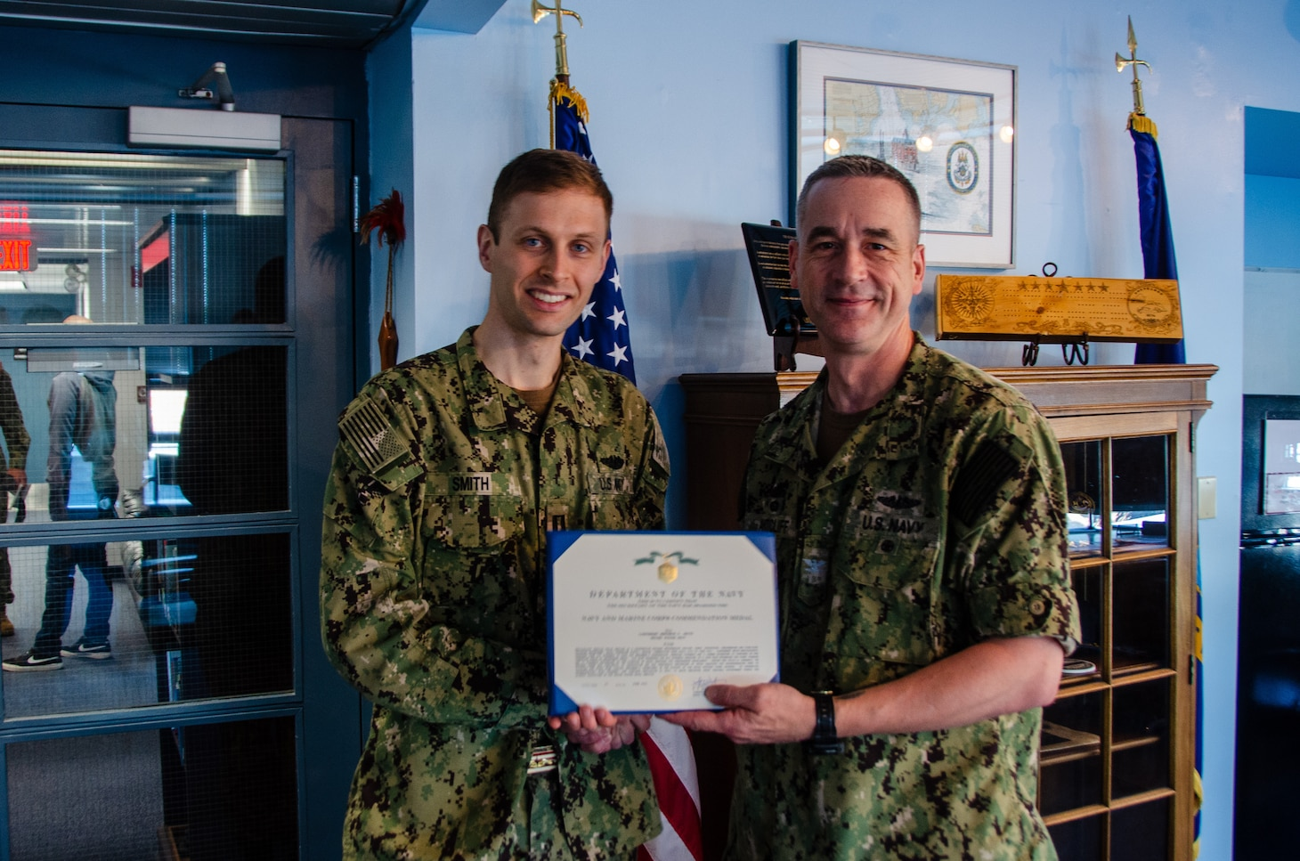Lt. Benjamin D. Smith is presented the Navy and Marine Corps Commendation Medal as an end-of-tour award by Capt. Steven W. Antcliff, commanding officer, Naval Submarine School, aboard Naval Submarine Base New London in Groton, CT on May 19, 2021. As the Prospective Nuclear Engineering Officer (PNEO) for the Naval Submarine School, Smith ensured that over 150 office students passed the engineer examination, providing highly qualified new department heads to the submarine force. Additionally, Smith's innovation which allowed for continued instruction with no interruption to the training pipeline during the COVID-19 pandemic. (U.S. Navy photo by Charles E. Spirtos)