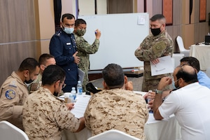 210525-N-IO414-1237 MANAMA, Bahrain (May 25, 2021) Personnel from the Bahrain Defense Force, U.S. Navy, U.S. Army, U.S. Embassy in Bahrain and U.S. Agency for International Development (USAID) Humanitarian Assistance Advisers discuss a case study during a Humanitarian Operations Workshop hosted by the Bahrain Ministry of Interior, and facilitated by U.S. Naval Forces Central Command (NAVCENT) and USAID in Manama, Bahrain, May 25. NAVCENT is the U.S. Navy element of U.S. Central Command in the U.S. 5th Fleet area of operations and encompasses about 2.5 million square miles of water area that includes the Arabian Gulf, Gulf of Oman, Red Sea and parts of the Indian Ocean. (U.S. Navy photo by Mass Communication Specialist 2nd Class Jordan Alexander Crouch)