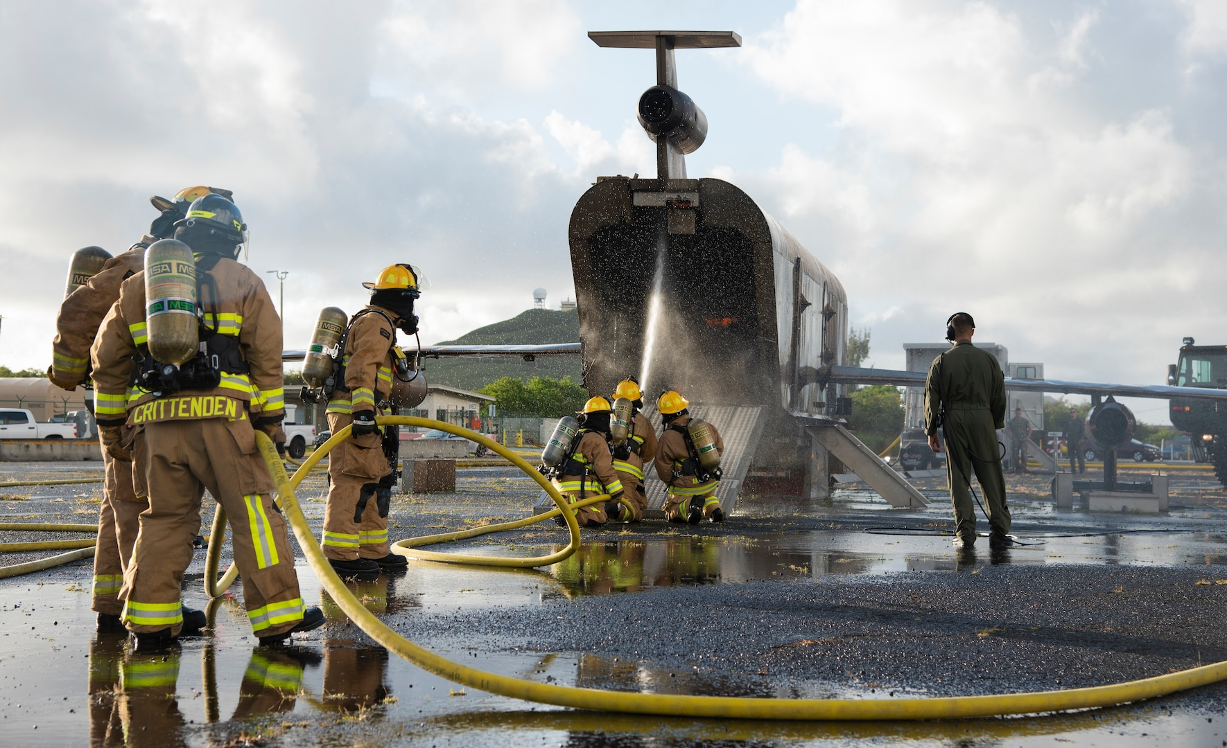 Firefighters from the Oregon Air National Guard's 142nd Wing conduct a live-fire exercise with Marine Corps firefighters at Marine Corps Base, Hawaii, May 14, 2021. This burn is part of a larger scale joint exercise that includes aircraft familiarization, egress training, and co-training and mentoring less experienced firefighters.