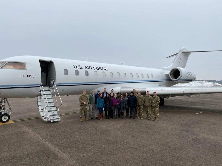 Members of the Battlefield Airborne Communications Node program office, headquartered here, pose next to a Bombardier Global 6000 at Bradley International Airport in Windsor Locks, Conn., in Nov. 2019. On June 1, the team awarded a $464.8 million contract to Learjet, Inc., a the U.S. subsidiary of Bombardier Inc. The five-year indefinitely quantity, indefinitely delivery contract provides funds for purchasing up to six Bombardier Global 6000 aircraft (Courtesy photo)