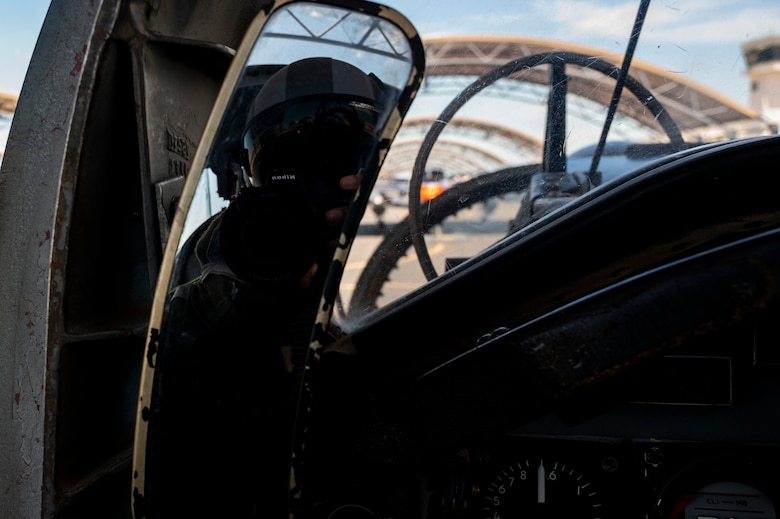 Airman 1st Class David Phaff sits waiting for take off to begin and capture photos and video of aircraft as they fly in several formations on May 2, 2021 at Corpus Christi, Texas. An aerial photography mission is to capture content while flying with pilots to help document the Air Force mission. (U.S. Air Force photo by Airman 1st Class David Phaff)
