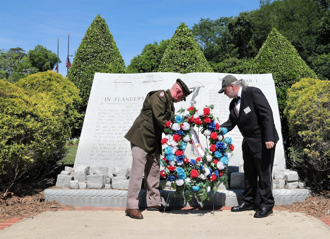 U.S. Army Reserve Col. Andrew T. Love, G4 for the U.S. Army Civil Affairs and Psychological Operations Command (Airborne), places a wreath representing those who served and were lost during World War I while participating in the 2021 Fayetteville, N.C., Memorial Day Ceremony to honor America's fallen military service members, May 31, 2021, at Freedom Memorial Park.