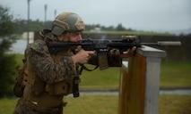 U.S. Marine with Amphibious Reconnaissance Platoon (ARP), 31st Marine Expeditionary Unit (MEU), conducts live fire drills on Camp Hansen, Okinawa, Japan, April 22, 2021.