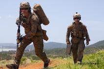 U.S. Marines with Amphibious Reconnaissance Platoon, 31st Marine Expeditionary Unit (MEU), conduct live fire drills on Camp Hansen, Okinawa, Japan, April 25, 2021.
