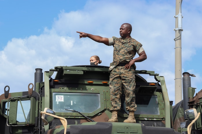 U.S Marine Corps Gunnery Sgt. Luckner Desma, chief, Motor Transport Operations goes over immediate action drills during a Vehicle Commander Course on Camp Hansen, Okinawa, Japan, April 20, 2021.