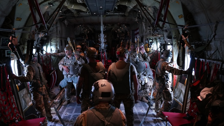 """Joint Readiness Training Center Operation Group Airborne parachutists standby for their static line jump from a C-130J Super Hercules May 27, 2021. The 815th Airlift Squadron, known as the """"Flying Jennies,"""" provided airlift and airdrop support during Voyager Shield, an exercise hosted by the 621st Air Mobility Advisory Group at the Joint Readiness Training Center and Fort Polk, La., May 25-27."""