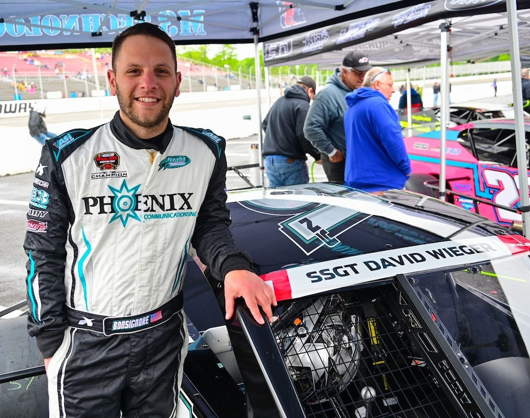 Justin Bonsignore, two-time Whelen Modified Tour champion, shows the name of  Staff Sgt. David Wieger, a fallen Office of Special Investigations special agent, on his Kenneth Massa Motorsports car, prior to his victory in the Jennerstown Salutes 150 race in Jennerstown, Pa., May 29, 2021. Bonsignore and 33 fellow drivers honored the memory of Fallen Heroes during the Memorial Day weekend event at the Jennerstown Speedway.