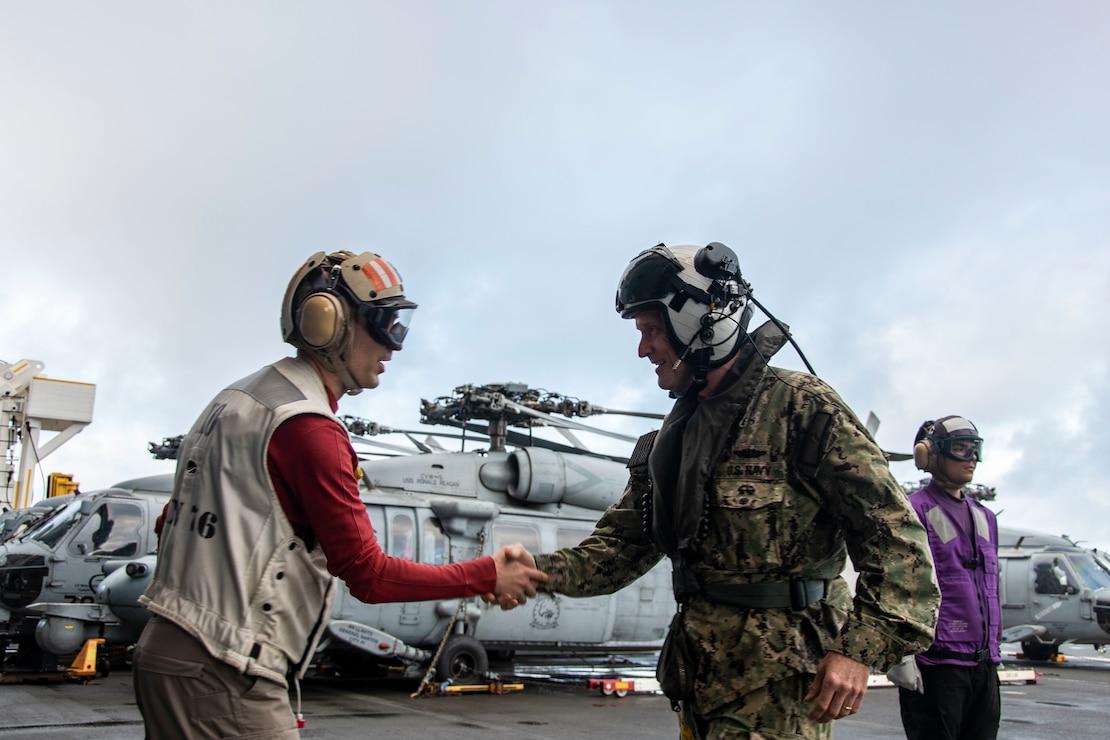 Capt. Matthew Ventimiglia greets Vice Adm. Bill Merz, commander, U.S. 7th Fleet, on the flight deck for a ship visit.