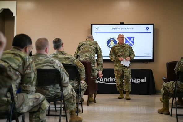 Col. Glenn Page, Air Force District of Washington command chaplain, introduces Maj. Gen. Steven A. Schaick, chief of chaplains, and Chief Master Sgt. Natalie Gray, U.S. Air Force religious affairs senior enlisted advisor, to the front of the room for an Annual Awards Presentation, at Chapel 1, Joint Base Andrews, Md., May 18, 2021. Typically, the Chief of Chaoplains and religious affairs senior enlisted advisor present the Air Force-level awards. (U.S. Air Force photo by Airman 1st Class Bridgitte Taylor)
