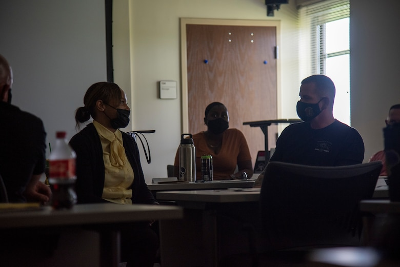 Two service members discuss a suicide intervention scenario during an Applied Suicide Intervention Skills Training (ASIST) course, led by Air Force Wounded Warrior Program (AFW2) leaders, at MacDill Air Force Base, Florida, May 12, 2021. 6th Air Refueling Wing first sergeants reached out to AFW2 to lead ASIST which is a suicide prevention and intervention program designed to teach participants life-assisting intervention skills from a community-based approach.