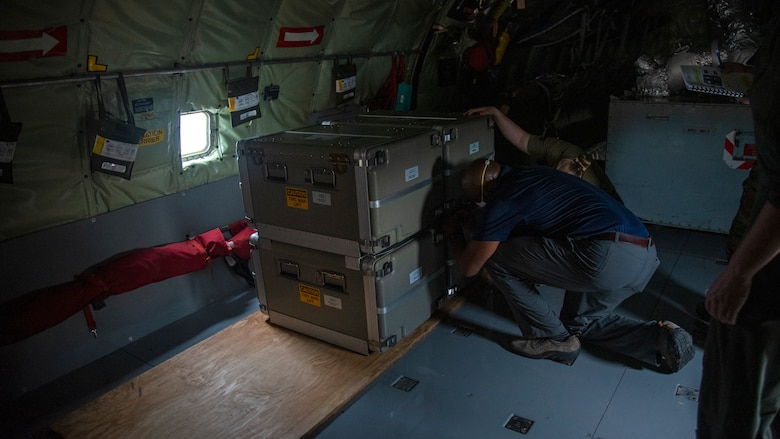 Millard Bolden, a Northrup Grummins and defense contractor employee, and U.S. Air Force Senior Airman Kylie Strawser, 50th Air Refueling Squadron (ARS) boom operator, secure a Roll-On Beyond-Line-Of-Sight Enhancement (ROBE) on a KC-135 Stratotanker aircraft at MacDill Air Force Base, Florida, May 13, 2021. 50th ARS members secured the ROBE in preparation for Exercise Mobility Guardian, Air Mobility Command's largest annual exercise in which two 50th ARS crews will participate in.