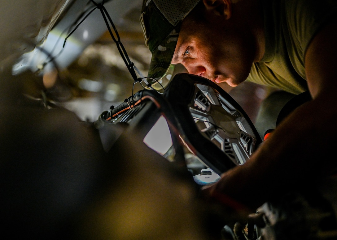 Senior Airman Ryan Knutson, 726th Expeditionary Air Base Squadron vehicle maintenance technician, works on an ambulance for the 776 Expeditionary Air Base Squadron fire department at Chabelley Airfield, Djibouti, May 25, 2021. Knutson has worked on over 50 vehicles during his deployment. (U.S. Air Force photo by Airman 1st Class Jan K. Valle)