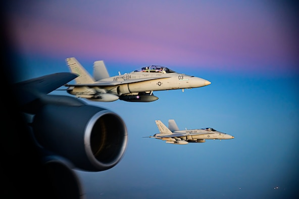 Two U.S. Marine Corp F/A-18D Hornet aircraft fly alongside a U.S. Air Force KC-135 Stratotanker aircraft during a mission supporting a dynamic force employment, May 18, 2021. Dynamic operations and force employment in the theater highlight the U.S. military's ability to deploy and employ forces anywhere around the globe. (U.S. Air Force photo by Tech. Sgt. Robert Harnden)