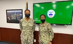 Navy Lt. Kimayah Fulcher, left, and Navy Capt. Kerri Yarbrough, right, pose for a photo following Fulcher's promotion to the rank of Lt., at a ceremony held at Defense Logistics Agency Distribution San Diego, California, May 3, 2021. (Photo by Navy Lt. Cmdr. Paul Damore)