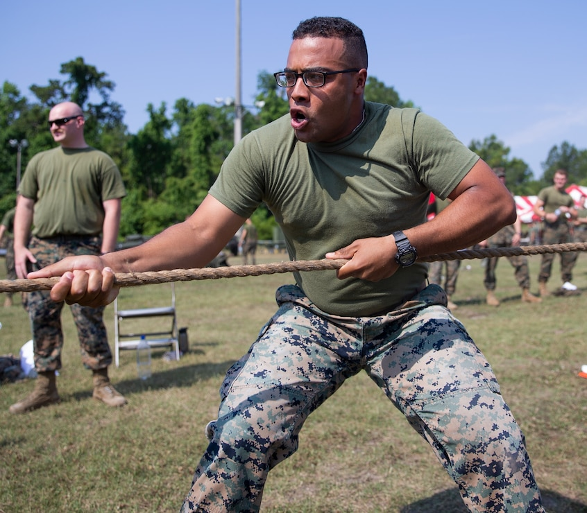 A Marine with 10th Marine Regiment (10th Marines), 2d Marine Division, competes in tug-of-war during the Kings Game at Camp Lejeune, N.C., March 27, 2021. The Kings Game is an annual event where Marines from 10th Marines compete in various competitions to strengthen the unit's esprit de corps. (U.S. Marine Corps photo by Lance Cpl. Michael Virtue)