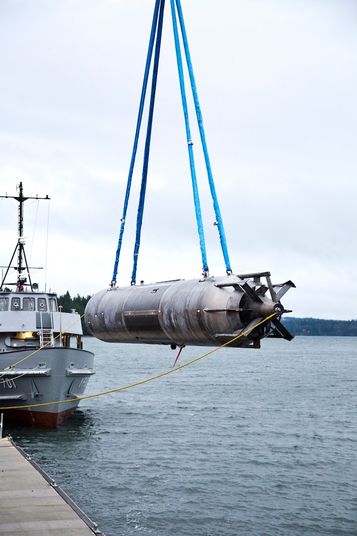 A surrogate Large Displacement Unmanned Undersea Vehicle (LDUUV) is submerged in the water in preparation for a test at the Naval Undersea Warfare Center Division Keyport in Puget Sound, Wash., in December 2015.