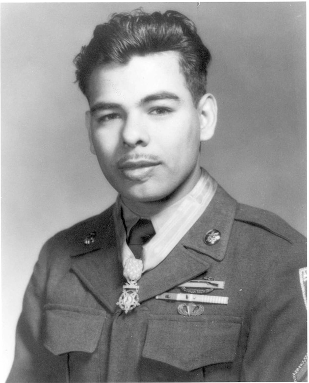 A man in uniform wears a medal around his neck.