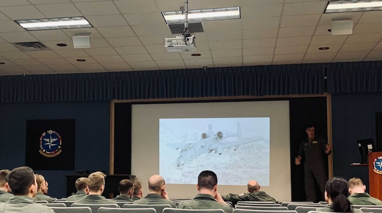 A photo of Airmen being briefed