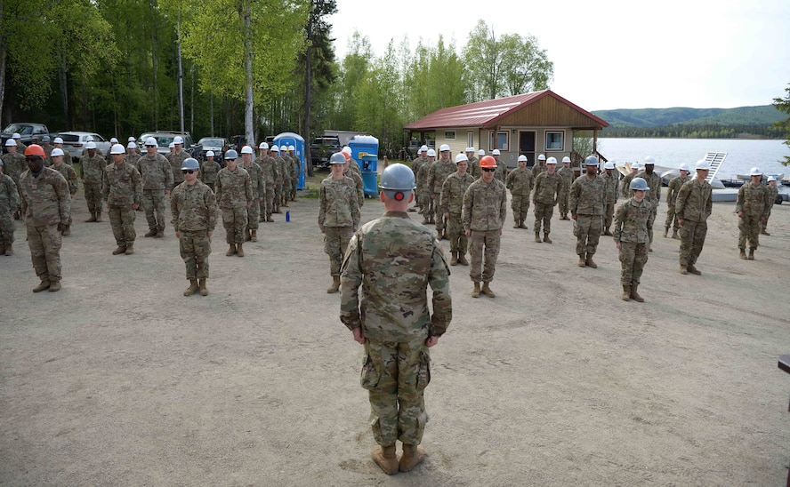 U.S. Air Force Lt. Col. Nicholas Van Elsacker, the 354th CES commander, takes charge of approximately 135 Airmen during a troop training project May 26, 2021, at the Birch Lake Military Recreation Area, Alaska. With such a successful turnout and results, the leaders of the 354th CES are looking at continuing to upgrade the recreation area little by little each year. (U.S. Air Force photo by Senior Airman Beaux Hebert)