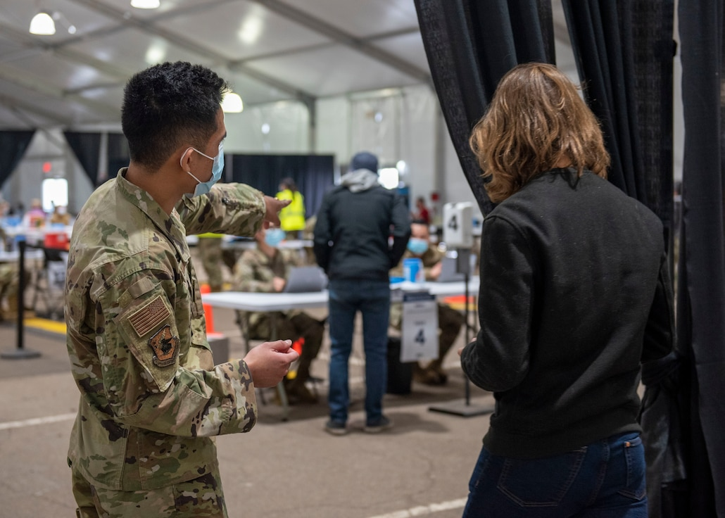 Airman talking to civilian