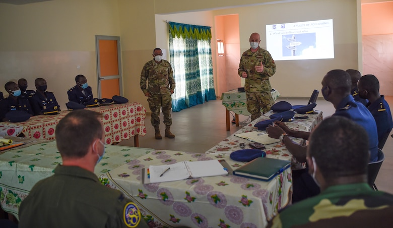 Chief Master Sgt. Terrance Smiley, Kisling Noncommissioned Officer Academy commandant, left, and Brig. Gen. Christopher Ireland, U.S. Air Forces in Europe-Air Forces Africa chief of staff, right, discuss leadership and followership with Senegalese air force members in Thies, Senegal, May 26, 2021. Throughout the engagement, Airmen facilitated several discussions with their Senegalese peers on topics such as leadership, airmanship, administrative processes, doctrine and personnel management.
