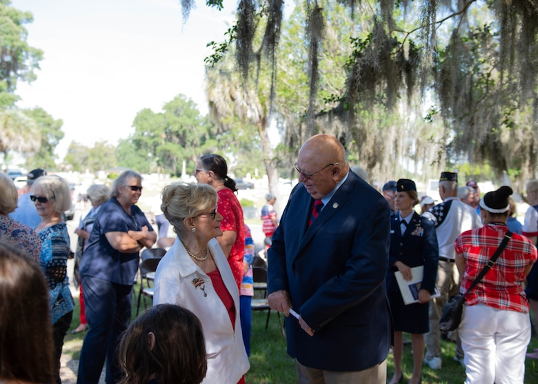 A photo of Dr. Lucy speaking with a community leader.