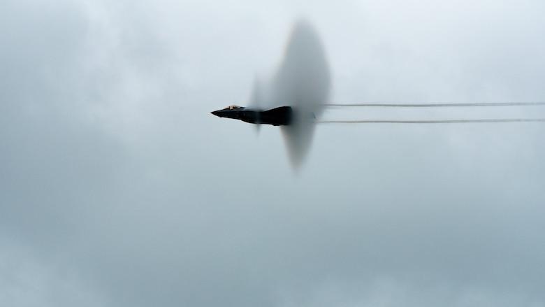 aircraft flying through vapor ring