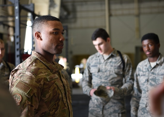 U.S. Air Force Staff Sgt. Nigel Jaggard, 315th Training Squadron assisting military training leader, motivates the 315th TRS student drill team before they compete in the 17th Training Group Drill Competition at the Louis F. Garland Department of Defense Fire Academy High Bay on Goodfellow Air Force Base, Texas, Feb. 7, 2020.  Jaggard trained and mentored the 312th Training Squadron, 315th TRS, and 316th TRS black rope Airmen through drill competitions. (U.S. Air Force photo by Airman 1st Class Abbey Rieves)