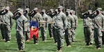 Soldiers assigned to Headquarters Company, 86th Infantry Brigade Combat Team (Mountain), Vermont National Guard, salute during their deployment ceremony at Camp Ethan Allen Firing Range, Jericho, Vermont, May 14, 2021. Family and friends gathered to support the Soldiers during the ceremony.
