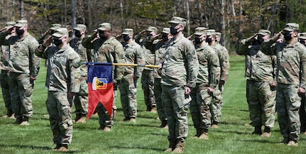Soldiers assigned to Headquarters Company, 86th Infantry Brigade Combat Team (Mountain), Vermont National Guard, salute during their deployment ceremony at Camp Ethan Allen Firing Range, Jericho, Vermont, May 14, 2021. Family and friends gathered to support the Soldiers during the ceremony. (U.S. Army National Guard photo by Joshua T. Cohen)