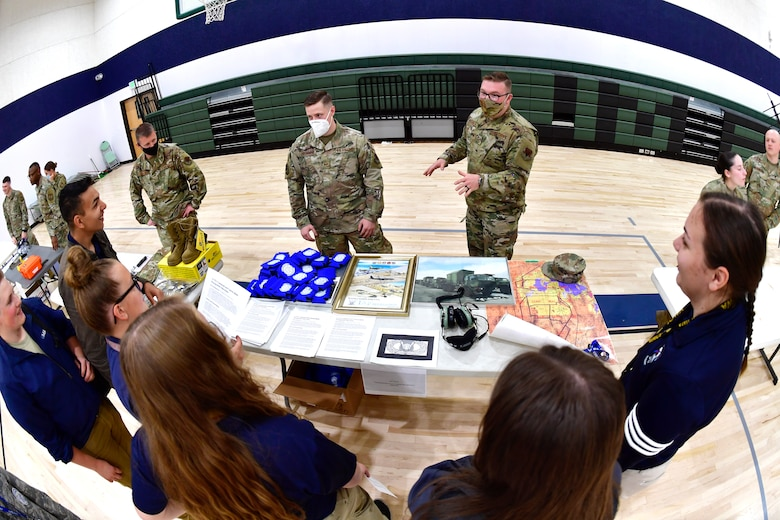 Senior Airman Nicolas Geanta, 729th Air Control Squadron, speaks with students while participating in a job fair at the Utah Military Academy, May 25, 2021, in Riverdale, Utah. Airmen from Hill Air Force Base recently hosted the event at the nearby charter high school to educate and inspire students, as well as promote interest in the possibility of future military careers. (U.S. Air Force photo by Todd Cromar)