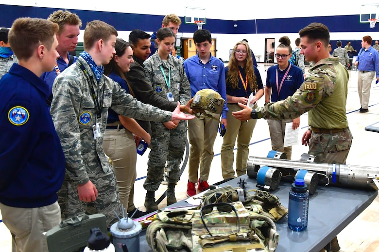 Airman First Class William Galuszka, 775th Civil Engineering Squadron, speaks with students about military equipment during a job fair at the Utah Military Academy, May 25, 2021, in Riverdale Utah. Airmen from Hill Air Force Base recently hosted the event at the nearby charter high school to educate and inspire students, as well as promote interest in the possibility of future military careers. (U.S. Air Force photo by Todd Cromar)