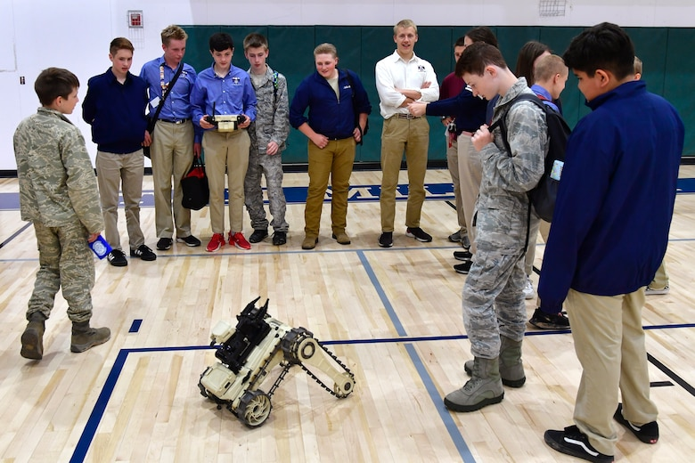 Students at the Utah Military Academy take turns driving a Micro Tactical Ground Robot at the explosive ordnance disposal display during a job fair May 25, 2021, in Riverdale, Utah. Airmen from Hill Air Force Base recently hosted the event at the nearby charter high school to educate and inspire students, as well as promote interest in the possibility of future military careers. (U.S. Air Force photo by Todd Cromar)