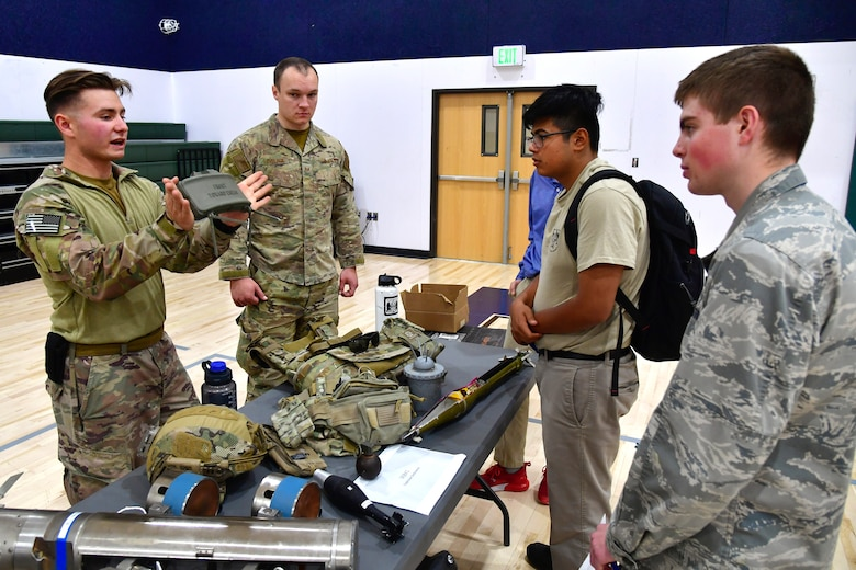 Airman First Class William Galuszka, 775th Civil Engineering Squadron, speaks with students about explosive devices while participating in a job fair at the Utah Military Academy, May 25, 2021, in Riverdale Utah. Airmen from Hill Air Force Base recently hosted the event at the nearby charter high school to educate and inspire students, as well as promote interest in the possibility of future military careers. (U.S. Air Force photo by Todd Cromar)