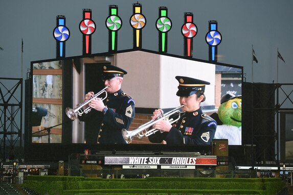 Master Sgt. Ward Yager (left) and Staff Sgt. Tiffany Hoffer, with the United States Army Field Band Brass Quintet, perform in Chicago, May 28, 2021 for Memorial Day weekend at the Chicago White Sox home game versus the Baltimore Orioles.