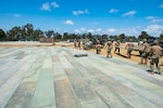 Seabees place AM-2 matting for a vertical take-off and landing site during an airfield damage repair assessment as part of Command Post Exercise 3 on board Naval Base Ventura County, Port Hueneme.