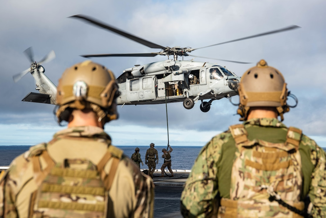 Sailors  conduct fast-rope training from an MH-60S Sea Hawk on the flight deck of the U.S. Navy's only forward-deployed aircraft carrier USS Ronald Reagan (CVN 76).