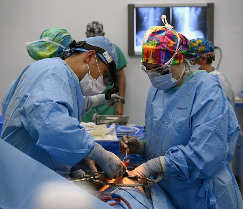 U.S. Army Lt. Col. Andrew Mendedorp (left), the chief of urology at Tripler Army Medical Center, Honolulu, Hawaii, and U.S. Air Force Lt. Col. Necia Pope (right), a urologist with the 59th Medical Wing, Joint Base San Antonio-Lackland, operate on a patient at Hospital del Sur in Choluteca,
