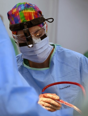 Air Force Lt. Col. Necia Pope, a urologist with the 59th Medical Wing, Joint Base San Antonio-Lackland, operates on a patient