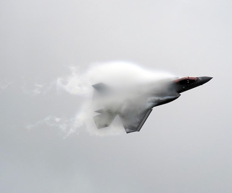 airplane flying through vapor cloud