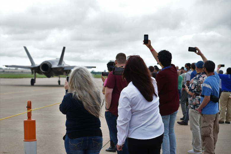 Group of people looking at an aircraft