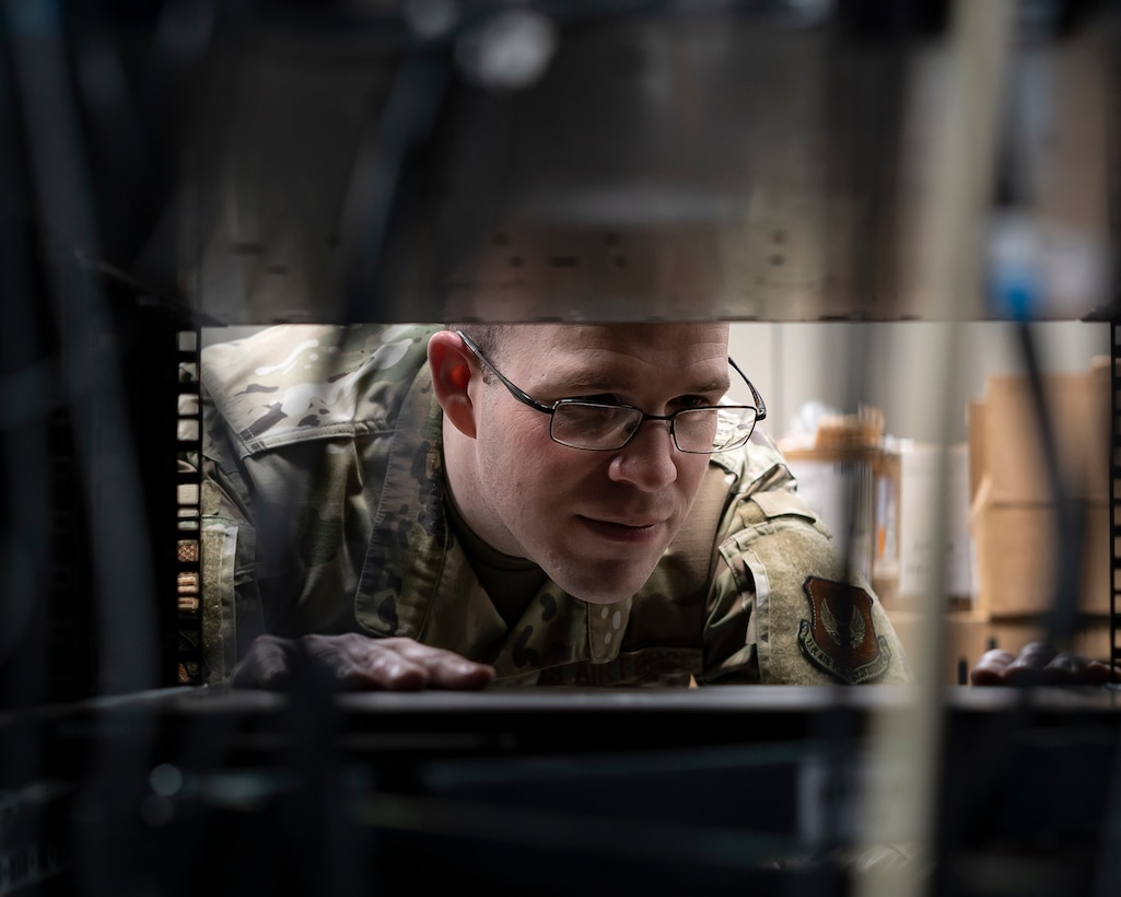 U.S. Air Force Staff Sgt. Edward Champa, 48th Communications Squadron cyber secure supervisor, works on a server at Royal Air Force Lakenheath, England, May 25, 2021. The 48th CS won the Lt. Gen. Harold W. Grant Award for best small communications squadron in the U.S. Air Force for the Oct. 1, 2019 to Sept. 30, 2020 time period. (U.S. Air Force photo by Senior Airman Jessi Monte)