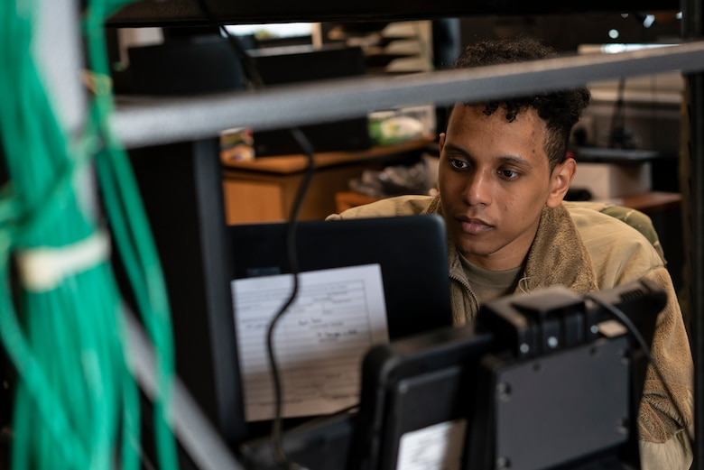 U.S. Air Force Airman 1st Class Xeryus Lee, 48th Communications Squadron client systems technician, troubleshoots computer equipment at Royal Air Force Lakenheath, England, May 25, 2021. The 48th CS won the Lt. Gen. Harold W. Grant Award for best small communications squadron in the U.S. Air Force for the Oct. 1, 2019 to Sept. 30, 2020 time period. (U.S. Air Force photo by Senior Airman Jessi Monte)