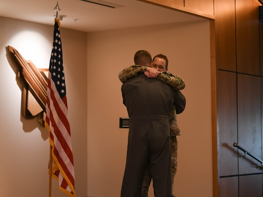 Grabham embraces Garcia after conducting the oath of enlistment