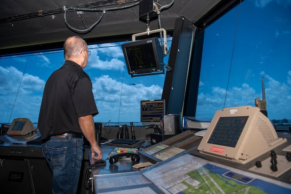 Donald Beckwith, 45th Logistics Readiness Squadron lead air traffic controller, watches a UH-60 Black Hawk helicopter fly over the airfield from inside the Patrick Space Force Base, Fla., tower May 18, 2021. Beckwith lead operations in the tower April 17 when a TBM Avenger made an emergency water landing near Patrick SFB. (U.S. Space Force photo by Tech. Sgt. James Hodgman)